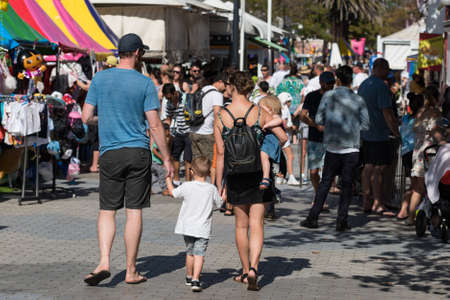 Sydney, Australia - April 21, 2019: family with children walking in the crowd on Cronulla Easter Show Editorial