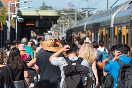 Train station with crowd of unrecognizable people. Rush hour public transport commute