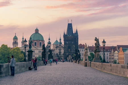 Charles bridge in Prague at sunrise with photographers and tourists. Travel in Europe, sightseeing Stock Photo