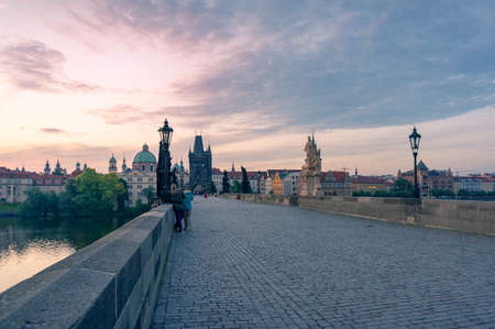 Charles Bridge with people on beautiful sunrise. visiting Prague, Czech Republic Stock Photo