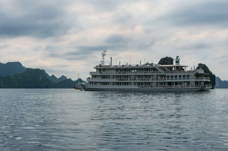 Cruise boat in Ha Long Bay tourist attraction area in Vietnam