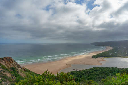 Beautiful aerial beach landscape of sandy ocean shore and green forest. Natures Valley, Garden Route South Africa