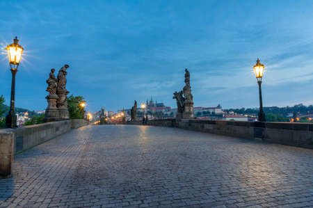 Perspective view of empty Charles Bridge before sunrise. Karluv Most at Prague, Czech Republic