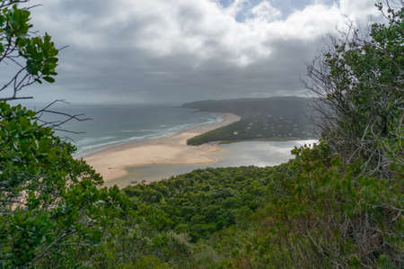 Landscape of beautiful ocean beach and forest. Natures Valley, South Africa Stock Photo