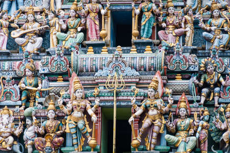 Singapore, Singapore - August 23, 2013: Colorful figures at the entrance to Hindu temple in Singapore Imagens