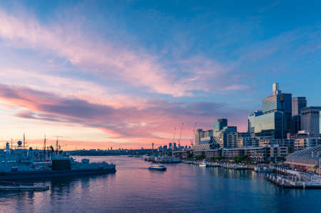 Modern cityscape with business office buildings and picturesque harbour at sunset. Darling Harbour, Sydney, Australia Stock Photo