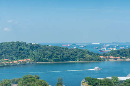 Aerial view of Singapore Sentosa island with view of ships and boats in the port