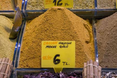 Carcade hibiscus powder in a heap in spice shop. Oriental cuisine spices Stock Photo