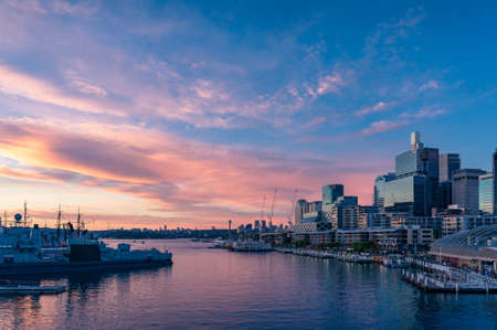 Sunset view over Sydney Harbour and business office buildings. Darling Harbour, Australia
