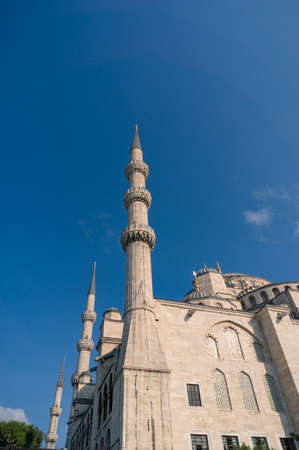 Minarets of Sultanahmed Mosque in Istanbul. Muslim international landmark against blue sky on the background. Istanbul, Turkey