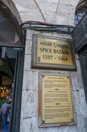 Istanbul, Turkey - August 27, 2013: Sign and history information for tourists at Spice Bazaar entrance