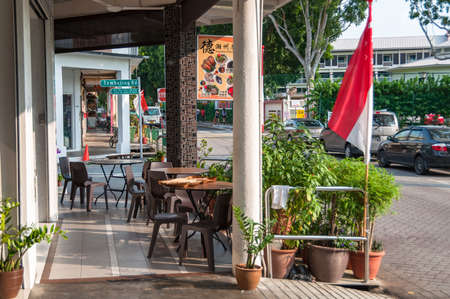 Singapore, Singapore - August 23, 2013: Outdoor restaurant setting with tables and chairs in Singapore street Sajtókép