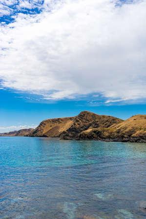 Mountain coastline with deep blue ocean water landscape. Nature background