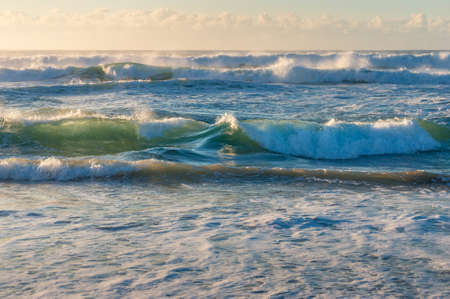 Spectacular storm ocean waves with white spray foam nature background Stock Photo