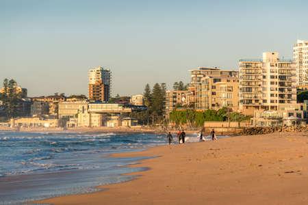 Sydney, Australia - Cronulla beach with surfers near the ocean waters edge