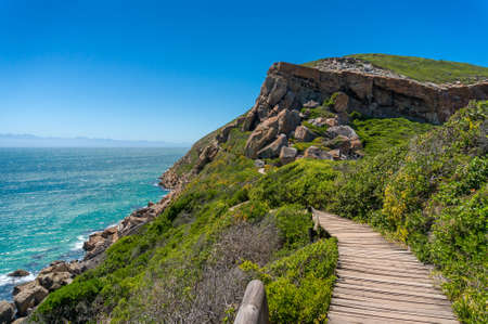 Wooden trek, path on a cliff with ocean on the background. Explore South Africa tourism nature background