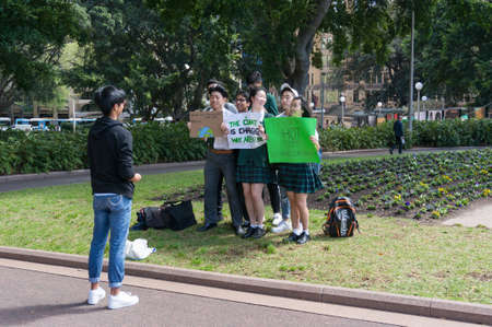 Sydney, Australia - September 20, 2019: Strike for climate change in Sydney. School children taking photos on climate change strike