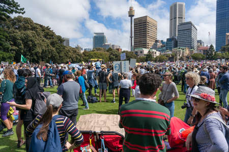 Sydney, Australia - September 20, 2019: Strike for climate change in Sydney. People demanding climate actions from the Australian government with Sydney cityscape on the background Redakční