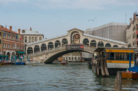 Venice, Italy- September 27, 2013: Rialto bridge on Grand Canal, famous Venetian landmark