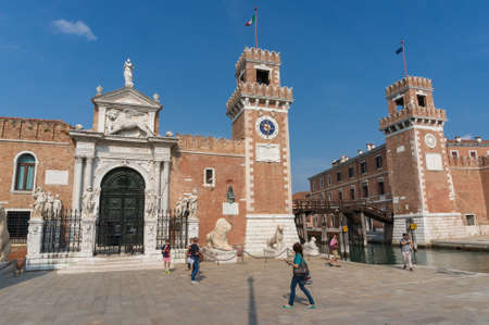 Venice, Italy- September 27, 2013: Venetian Arsenal building with lion statues and tourists