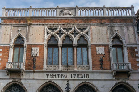 Venice, Italy- September 27, 2013: Old historic building with letters Teatro Italia, Italian theatre on facade