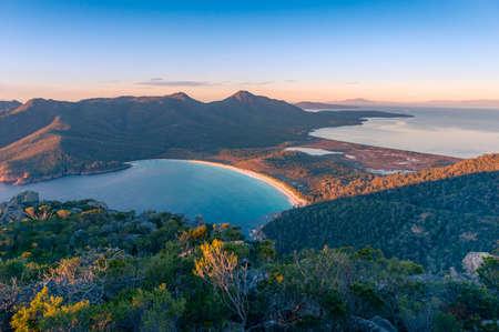 Sunrise nature landscape of beautiful ocean bay, lagoon and mountains. Wineglass bay in Tasmania, Australia