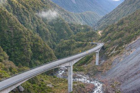 Mountain bridge road, viaduct bridge in the gorge. Otira Viaduct in West Coast district, New Zealand