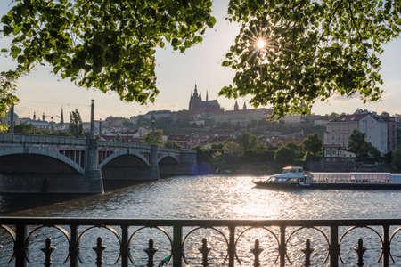 Prague, Czech Republic - May 22, 2018: Prague cityscape with historic Prague castle and cruise ship on Vlatava river