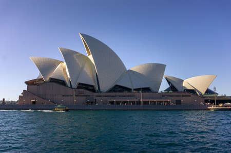 Sydney, Australia - July 23, 2016: Profile view of Sydney Opera House building at clear day. Sydney iconic landmark silhouette with waterview