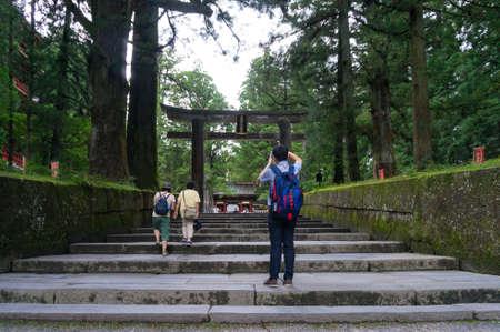 Nikko, Japan: September 9, 2016: Tourist taking photos of Nikko Toshogu Outer Torii or Ishidorii gate in Nikko, Japan 報道画像