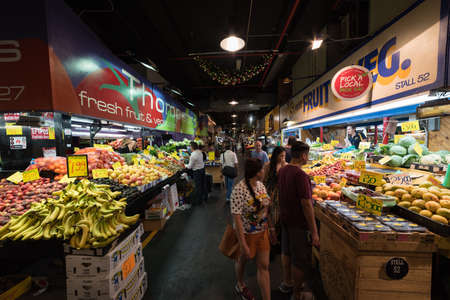 Adelaide, Australia - November 11, 2017: People at Adelaide fresh food market selling and buying fresh produce 報道画像