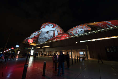 Sydney, Australia - June 11, 2016: Vivid Sydney light festival. Colorful laser show projecting aboriginal art light patterns on Sydney Opera House