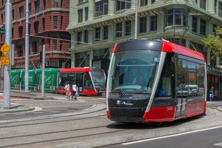 Sydney, Australia - January 26, 2020: Modern red tramway on George street in Sydney CBD
