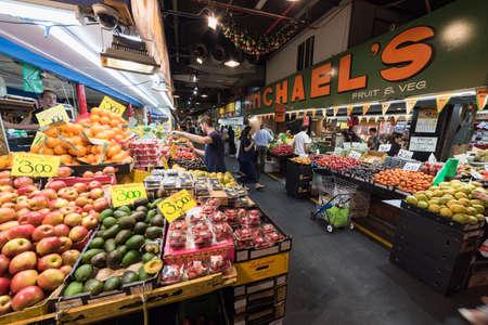 Adelaide, Australia - November 11, 2017: People at Adelaide fresh food market selling and buying fresh produce Editorial