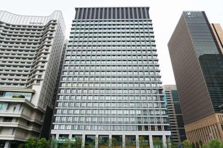 Tokyo, Japan - August 30, 2016: Marunouchi Garden Tower skyscraper building in Marunouchi financial district of Tokyo, Japan