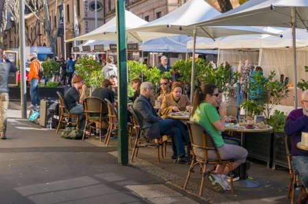 Sydney, Australia - July 23, 2016: People dining at outdoor restaurant in The Rocks precinct in Sydney