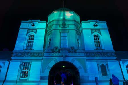 Sydney, Australia - June 11, 2016: Light projections on Taronga Zoo entrance building during Vivid Sydney light festival