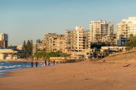 Sydney, Australia - April 14, 2017: Cronulla beach with surfers near the ocean waters edge