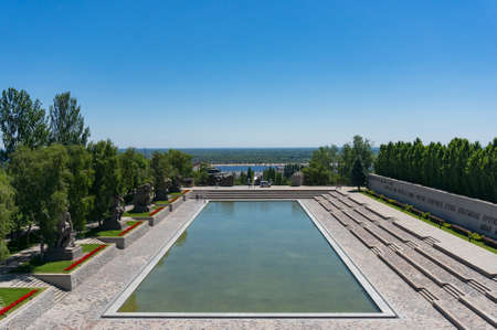 Volgograd, Russia - June 9, 2018: View of memorial pool on Mamayev Kurgan war memorial complex in Volgograd city. Cyrillic text commemorates feat of arms of defenders of the Stalingrad city