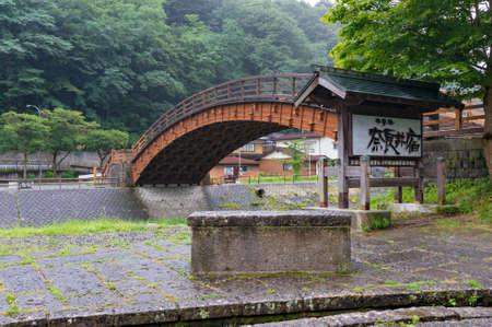 Narai, Japan - September 6, 2016: Wooden arch pedestrian bridge in Narai historic town in Kiso valley, Japan 報道画像
