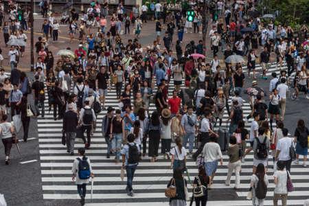 Tokyo, Japan - August 30, 2016: Crowd of people walking on Shinjuku pedestrian crossing in Tokyo, Japan