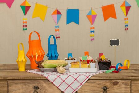 Decorated, colorful and cheerful table with typical sweet and savory foods to celebrate the Brazilian June party. `Festa Junina`.