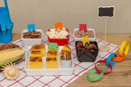 Brazilian June party table decorated with delicious typical sweets and savorys.