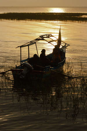 Little boat at lake Awassa in Ethiopia at sunset Stock Photo