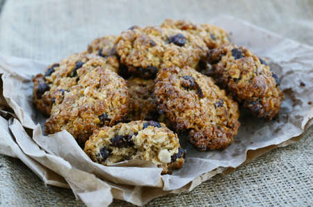 raisin: Homemade oatmeal cookies on canvas background