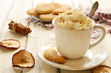 Coffee a la Vienne and shortcrust cookies on wooden table photo