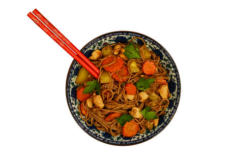 buckwheat noodle: Bowl with homemade stewed buckwheat noodle soba with chicken, carrot, squash and coriander leaves and red chopsticks isolated on white
