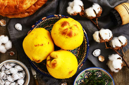 quinces: Quinces, flatbread, salty apricot pits and cotton buds in oriental way