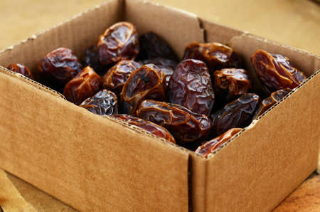 selective focus: Dried dates in cardboard box, selective focus Stock Photo