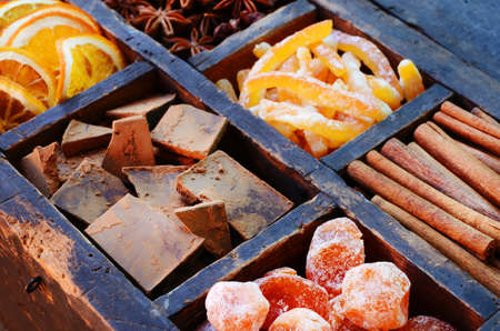 dried orange: Dark chocolate, kumquats, dried orange slices, cinnamon, candied peels and star anise in old wooden crate